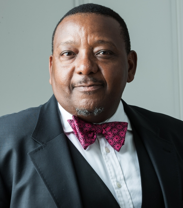NKOREGAMBA MWEBESA - CHIEF EXECUTIVE